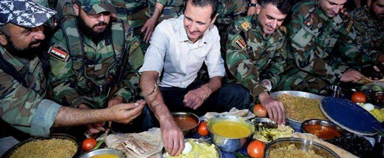 بالفيديو…الأسد يتناول الإفطار مع جنود الجيش السوري
