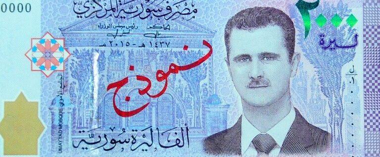 الليرة السورية تتحسن أمام الدولار..