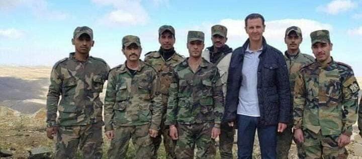 الأسد وعائلته في نقطة للجيش بريف دمشق (صور)
